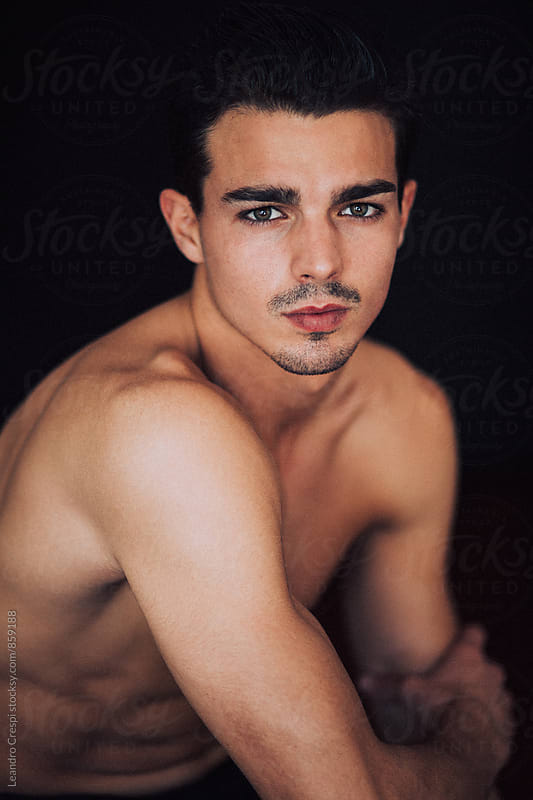 Closeup portrait of a young male by Leandro Crespi for Stocksy United