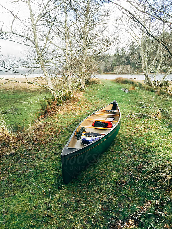 Green Canoe Ashore by Luke Mattson for Stocksy United