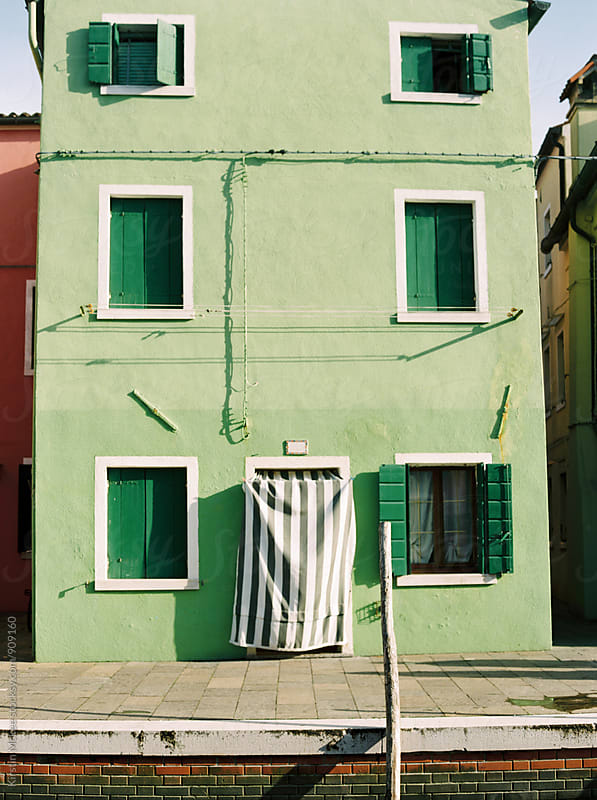Green house in Burano, Venice by Kirstin Mckee for Stocksy United