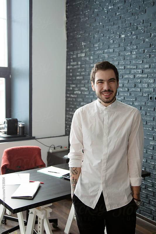 Smiling bearded man in white shirt by Danil Nevsky for Stocksy United