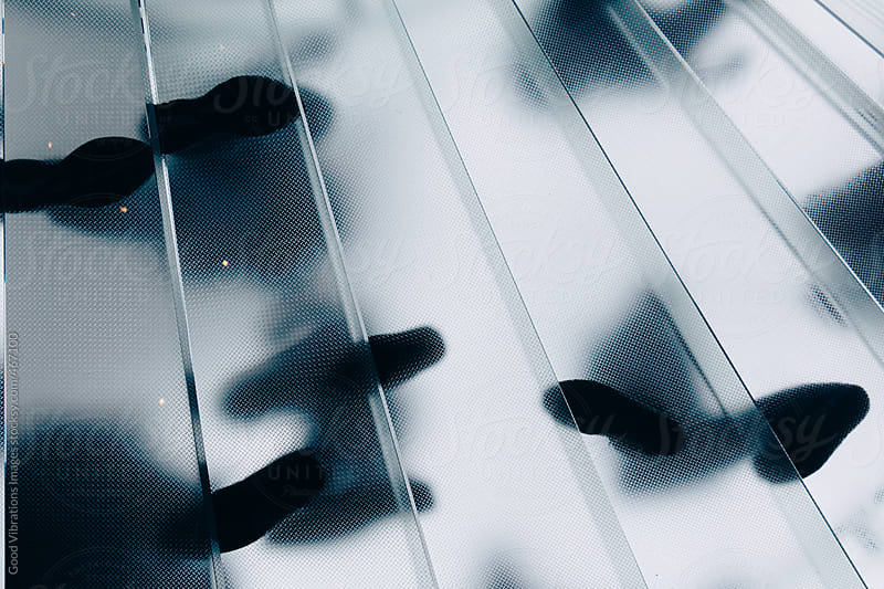 People on a glass stairway by Good Vibrations Images for Stocksy United