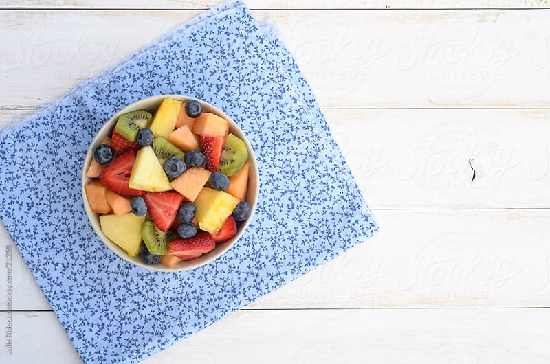 Bowl of fruit salad by Julie Rideout for Stocksy United