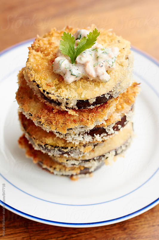 Breaded Eggplant with Spicy Walnut Yogurt Sauce by Harald Walker for Stocksy United