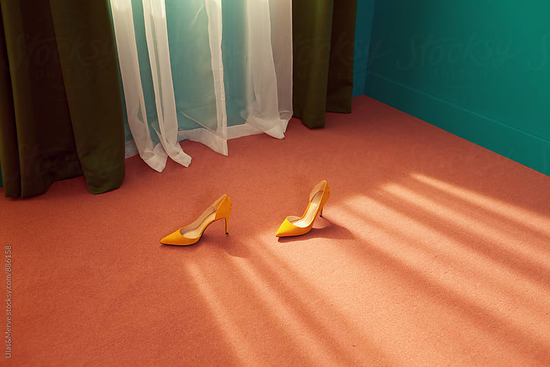 conceptual fashion image with high heels on pink flooring by Ulaş and Merve for Stocksy United