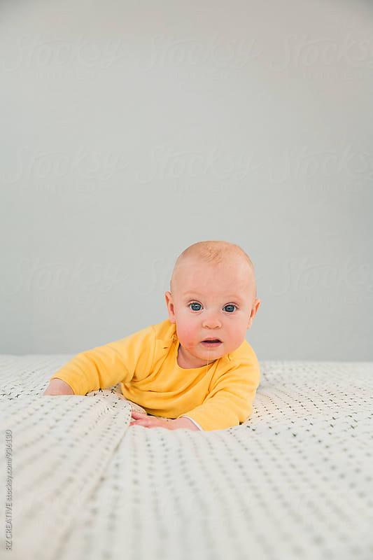 Newborn baby looking in camera.