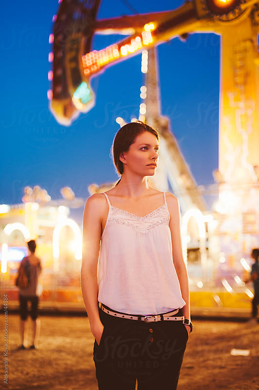 Beautiful woman at amusement park by Aleksandra Kovac for Stocksy United