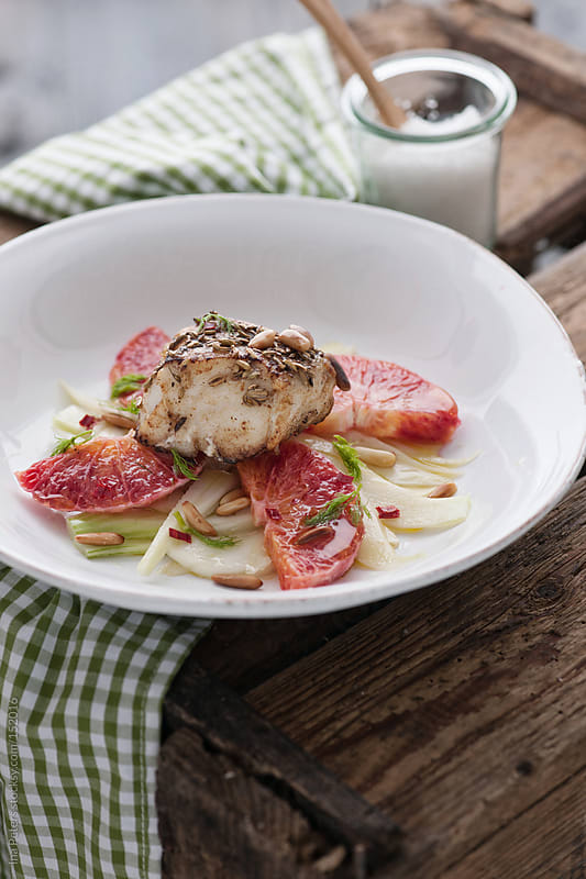 Food: Fennel and Blood Orange Salad with Fish, Cod by Ina Peters for Stocksy United