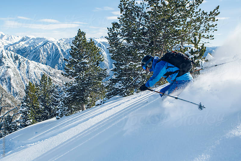 Skier man down the powder mountain in a sunny day by Blue Collectors for Stocksy United