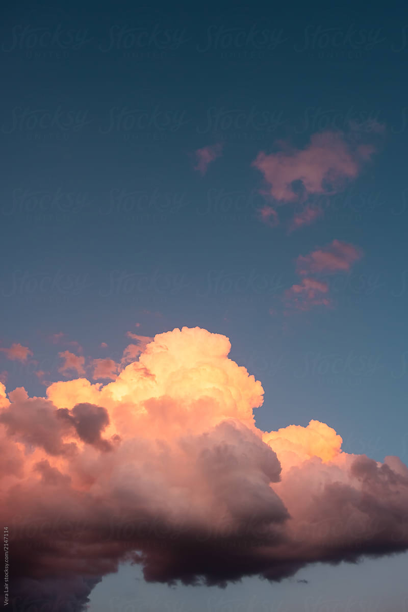 cumulus clouds at sunset stocksy united