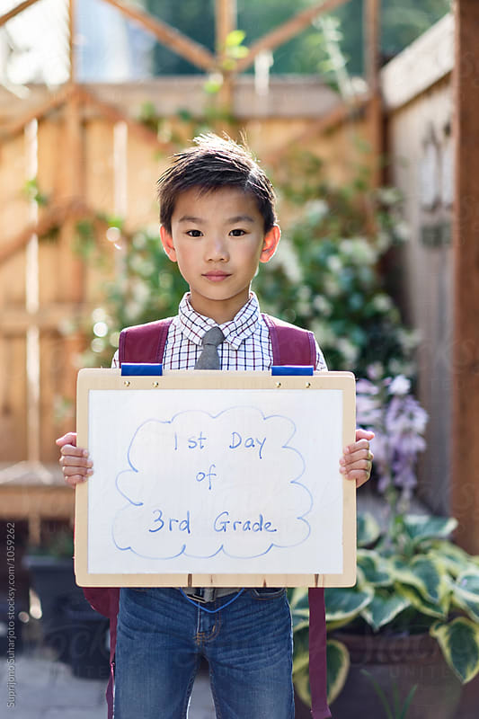 Back to school: Asian student on his first day going back to school by Suprijono Suharjoto for Stocksy United