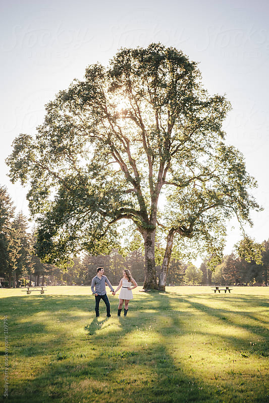 Couple with a big Oak tree by Shelly Perry for Stocksy United