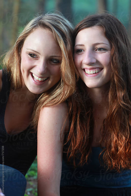 Two Beautiful Teen Girls Laughing Outdoors by Dina Giangregorio for Stocksy United