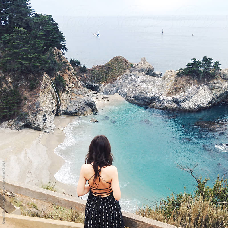 Woman taking in ocean view by Daniel Kim Photography for Stocksy United