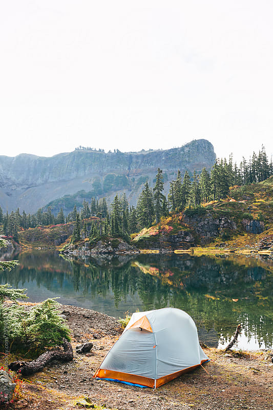 Camping Tent Pitched On Edge Of Subalpine Lake In Forest Wilderness by Luke Mattson for Stocksy United