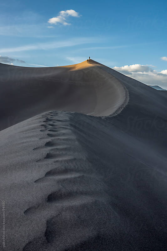 Hikers, climing great sand dunes at desert by yuko hirao for Stocksy United