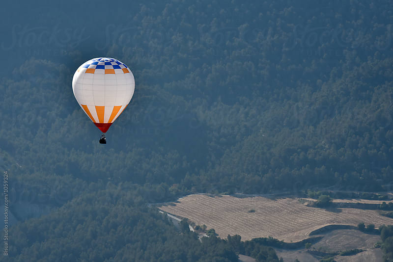 Hot air balloon flying by Bisual Studio for Stocksy United