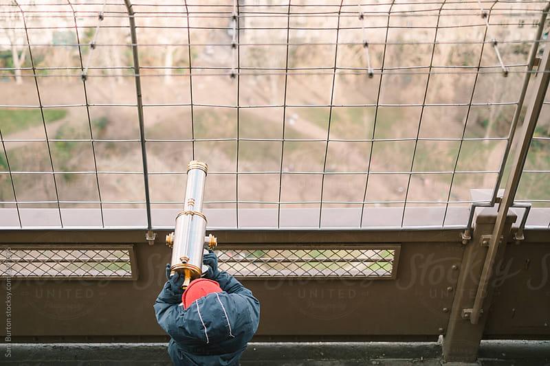 Boy with telescope by Sam Burton for Stocksy United