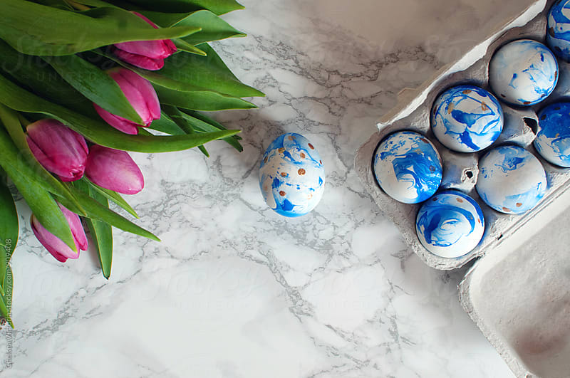 Marble easter eggs with gold polka dots by Chelsea Victoria for Stocksy United