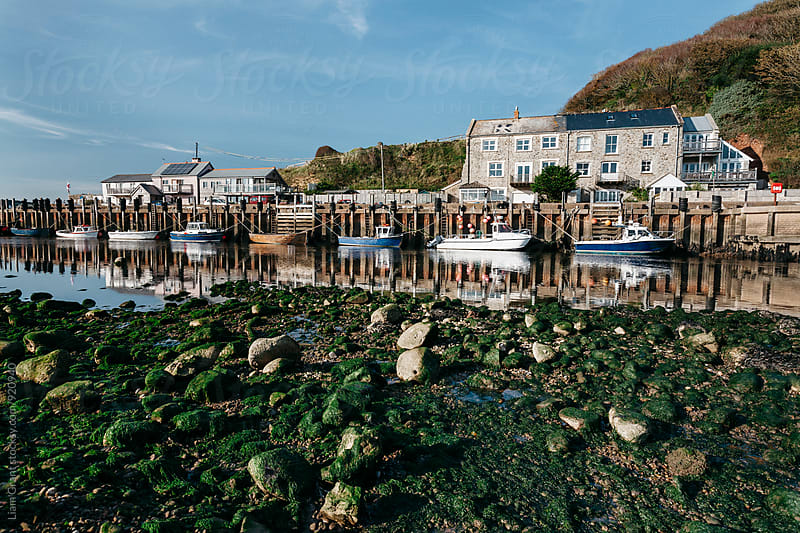Boats moored in the harbour at Seaton. Devon, UK. by Liam Grant for Stocksy United