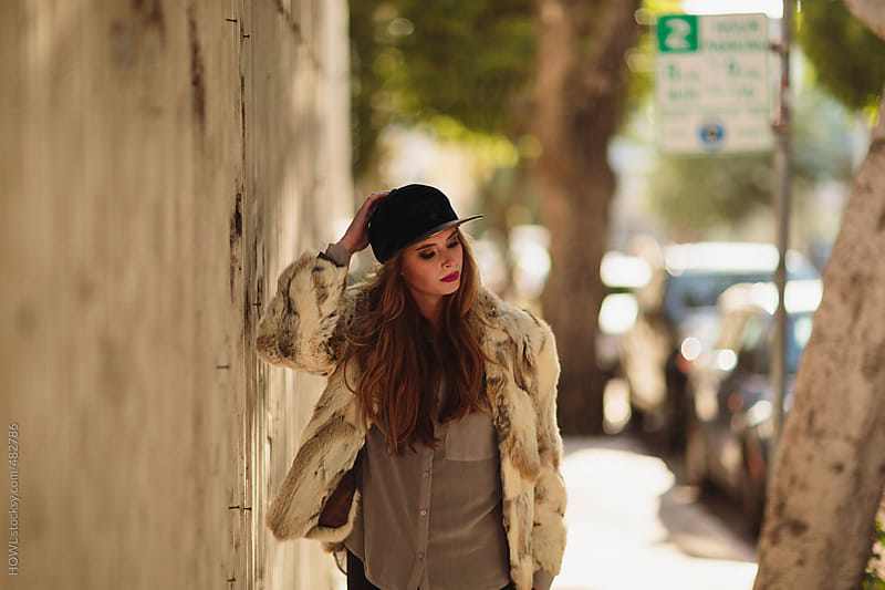 Trendy young woman walks down the San Francisco sidewalks by HOWL for Stocksy United