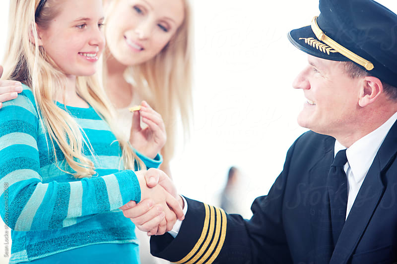 Airport: Shaking Hands with the Captain by Sean Locke for Stocksy United