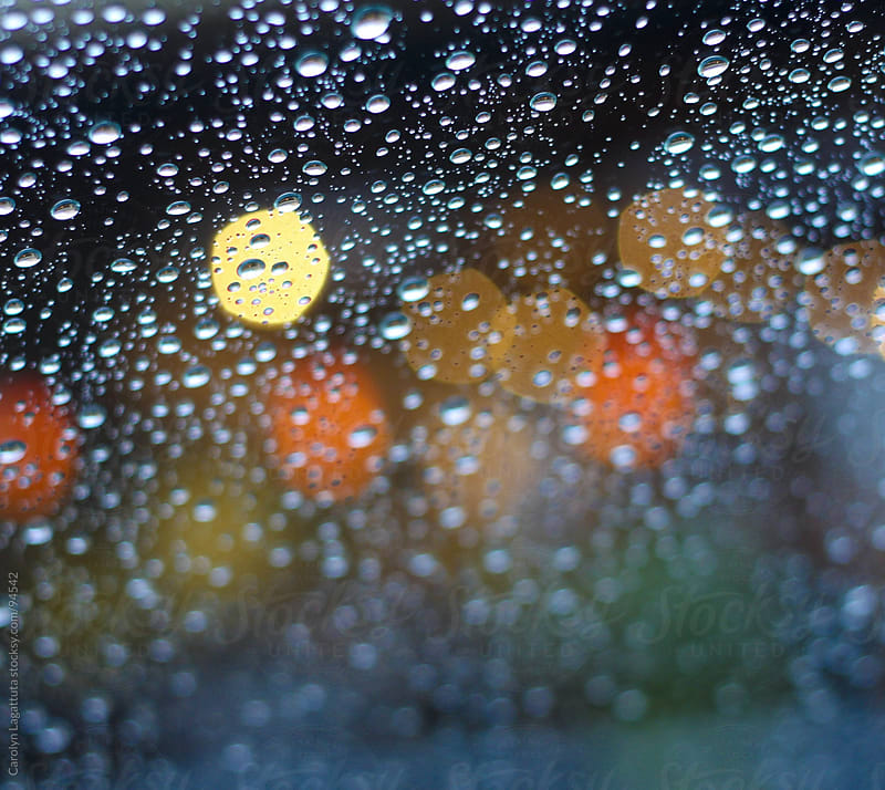 Droplets with lights in the background by Carolyn Lagattuta for Stocksy United