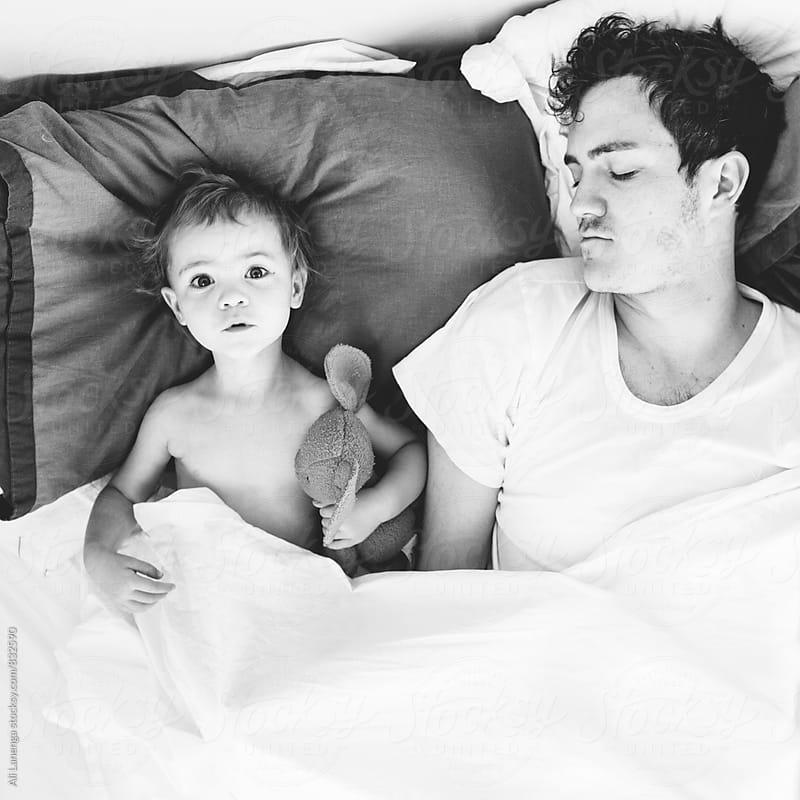 Dad, I'm awake! by Ali Lanenga for Stocksy United