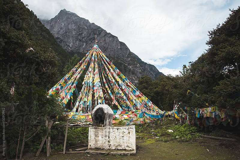 pagoda and prayer flags in the mountain by zheng long for Stocksy United
