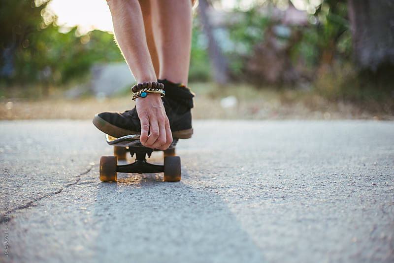 Summertime fun - woman skating in nature by Jovo Jovanovic for Stocksy United
