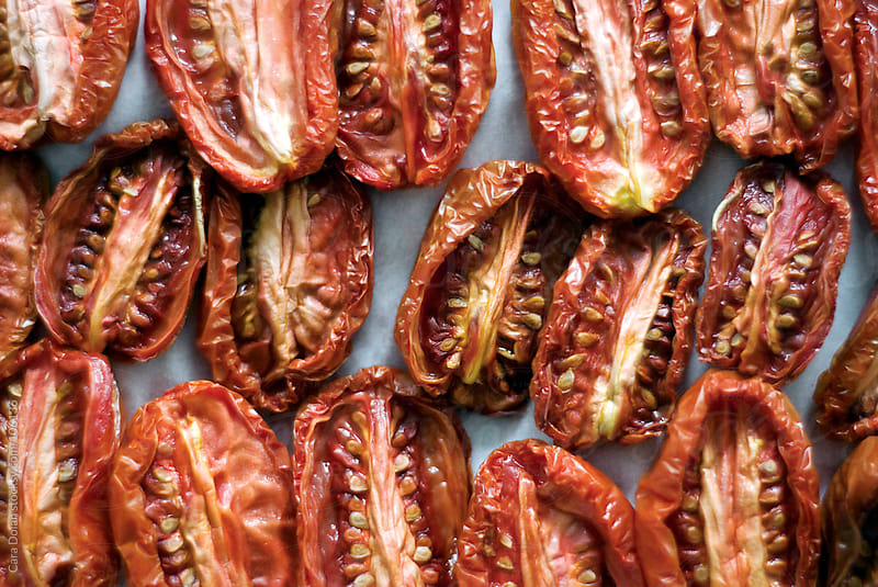 Sun-dried grape tomatoes by Cara Dolan for Stocksy United