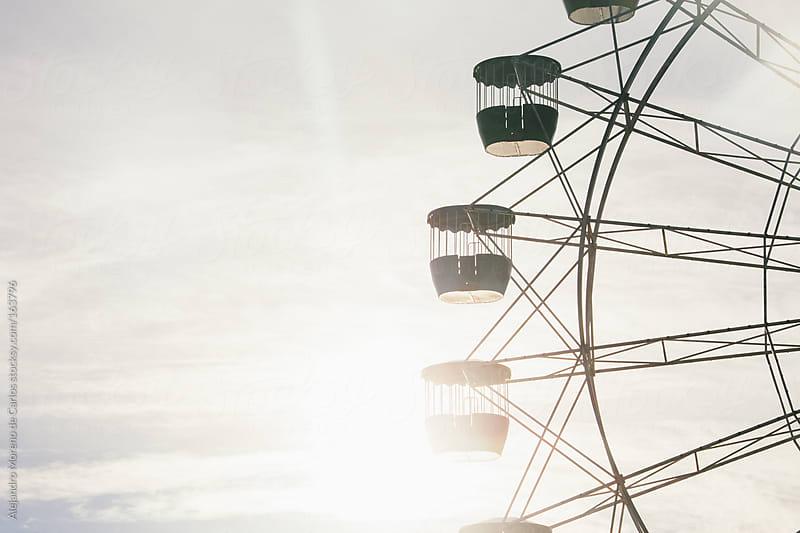 Ferris wheel at sunset in Sydney, Australia by Alejandro Moreno de Carlos for Stocksy United
