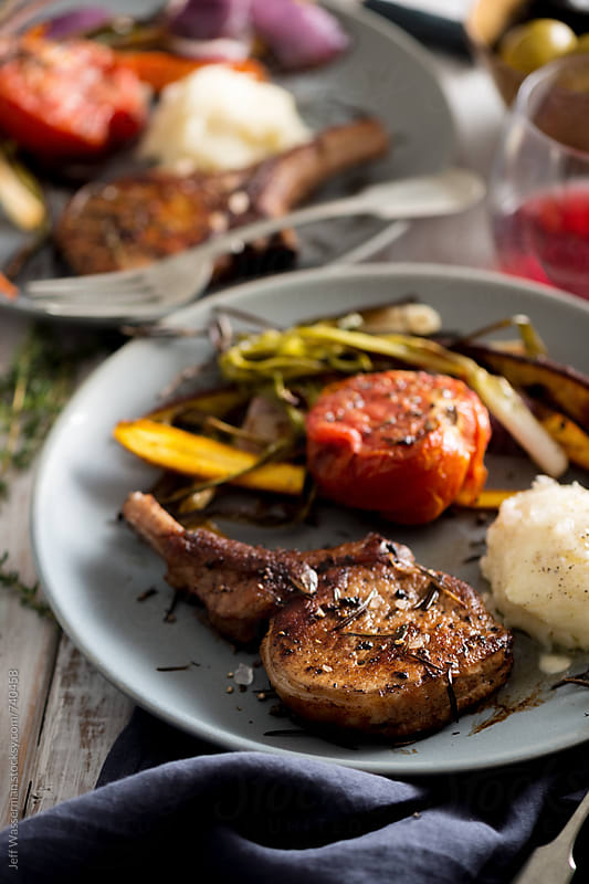 Pork Chops Roasted Vegetables and Potato by Jeff Wasserman for Stocksy United