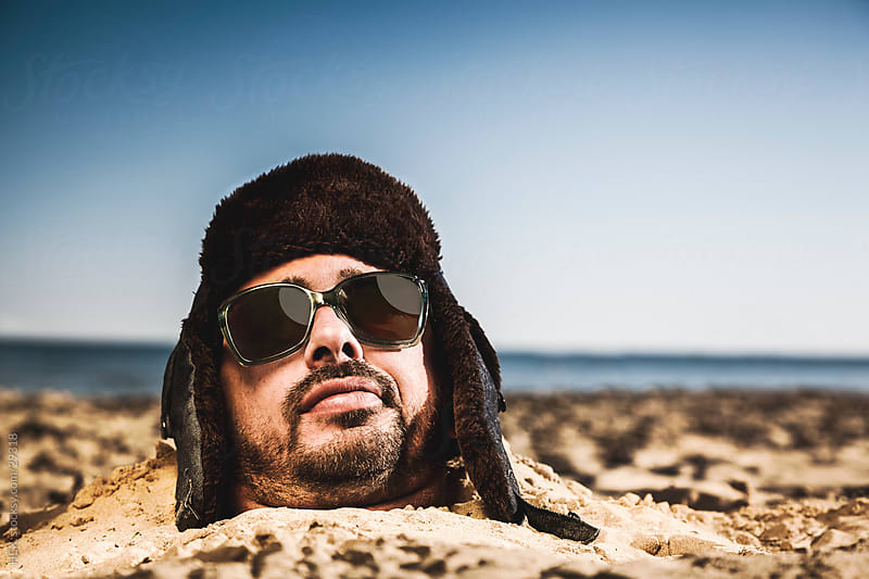 Man with Winter Hat . Hot Sand Bath Summer by HEX. for Stocksy United