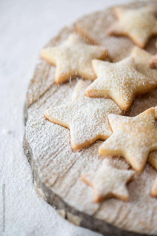 Star-shaped sugar-dusted shortbread cookies by Pixel Stories for Stocksy United
