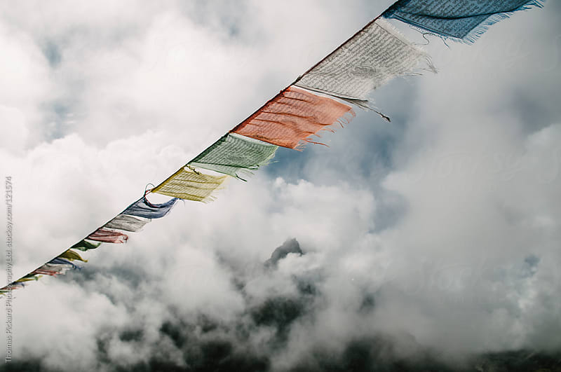 Clearing cloud, mountains and prayer flags, Everest Region, Sagarmatha National Park, Nepal. by Thomas Pickard Photography Ltd. for Stocksy United