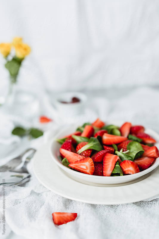 Vegan strawberry salad by Tatjana Ristanic for Stocksy United