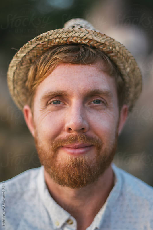 Hipster guy portrait on vacation by Nabi Tang for Stocksy United
