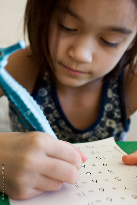 Girl Practicing Math  by Jill Chen for Stocksy United