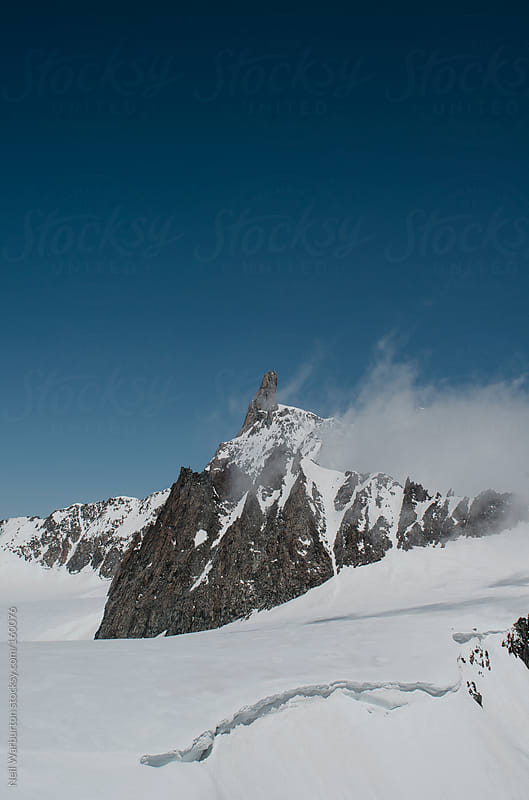 Alpine Peak in the Cloud by Neil Warburton for Stocksy United