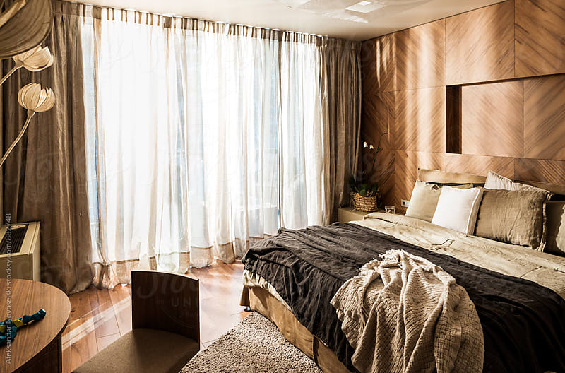 Contemporary bedroom by sunrise by Aleksandar Novoselski for Stocksy United