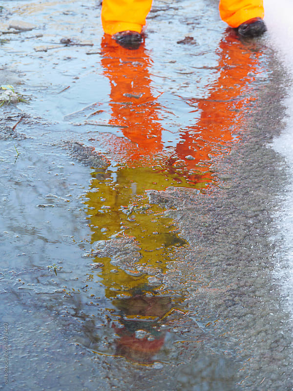 person reflection puddle wet by rolfo for Stocksy United