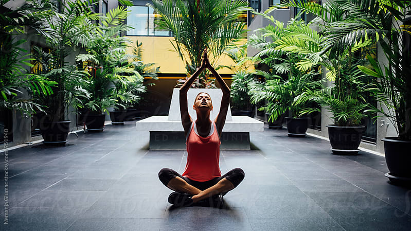 Young Woman Doing Yoga in The Garden by Nemanja Glumac for Stocksy United