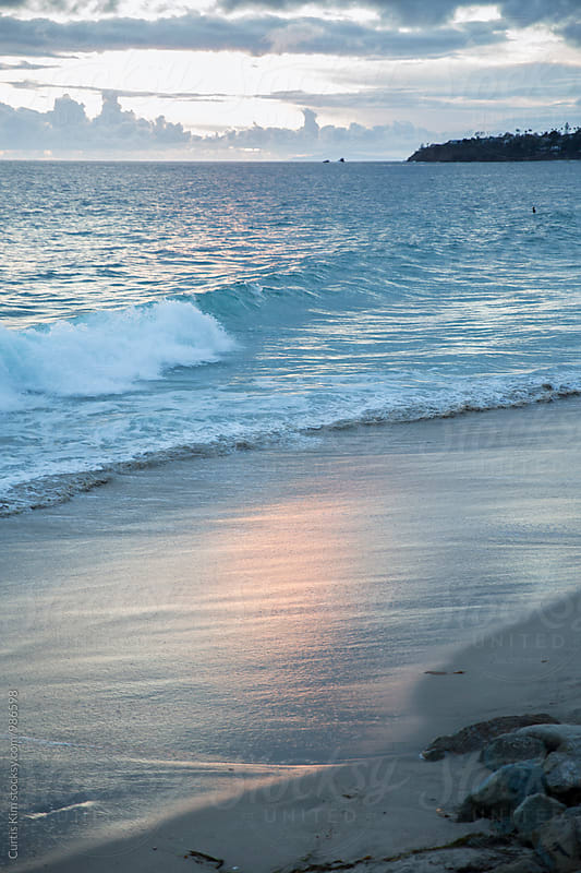 Waves along the coast at sunset by Curtis Kim for Stocksy United
