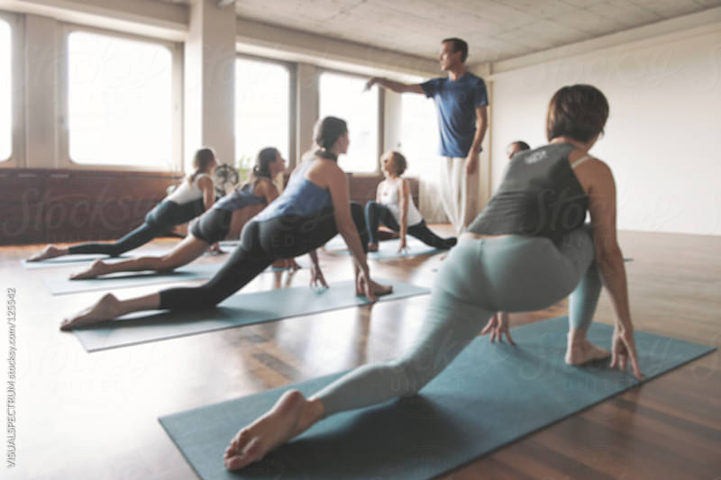 Yoga Class Defocused by VISUALSPECTRUM for Stocksy United