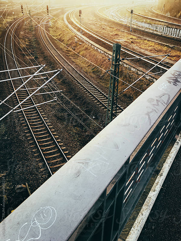 Sunset Light Over Railroad Tracks by Julien L. Balmer for Stocksy United