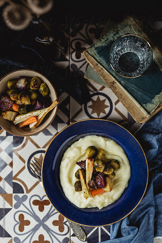 Mashed potatoes with roasted vegetables by Tatjana Zlatkovic for Stocksy United