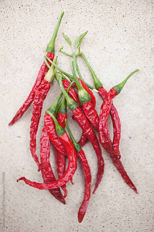 home grown, organic red chilli, dried. by Natalie JEFFCOTT for Stocksy United