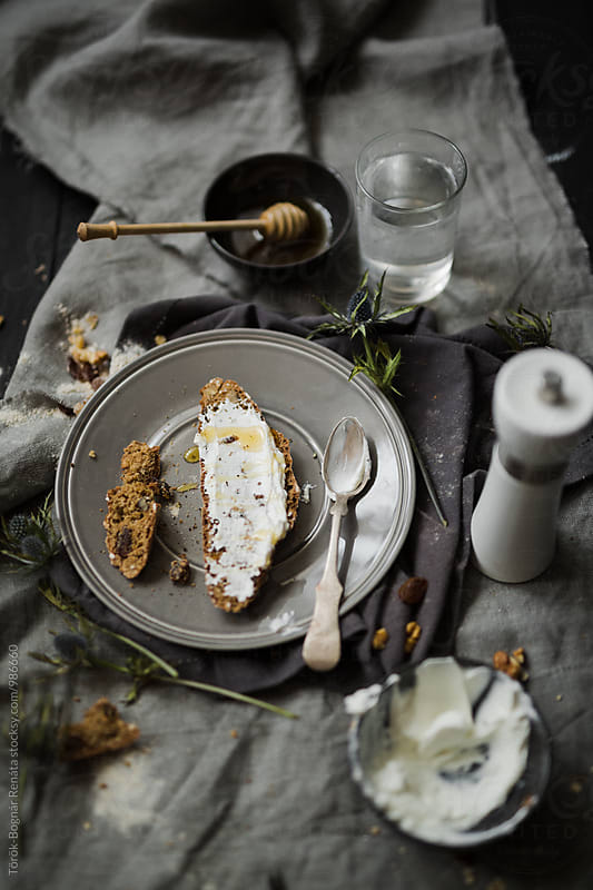 Oat sodabread slice with cheese and honey by Török-Bognár Renáta for Stocksy United