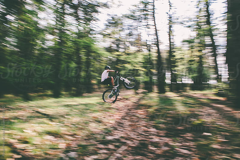 Man riding mountain bike - high speed panning by Peter Meciar for Stocksy United
