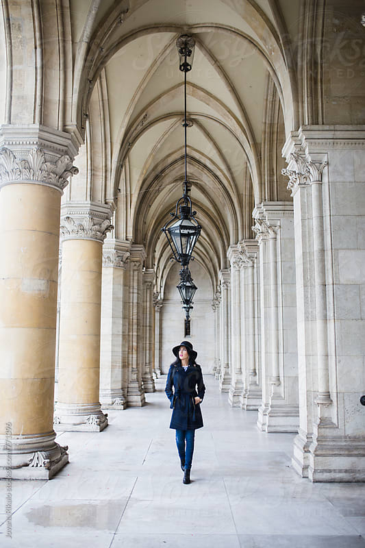 Young woman walking through city hall by Jovana Rikalo for Stocksy United